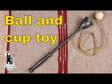 Ball and cup toy in forged iron