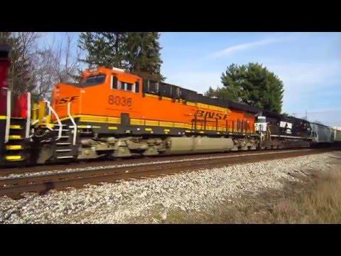 CN C40-8, BNSF ES44AC, NS DASH 9 pull CN and BNSF freight cars