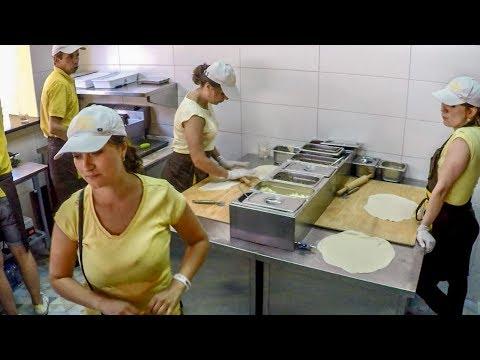 Preparing and Frying Chebureki, Meat Filled and Deep-Fried Dough. Kiev Street Food, Ukraine