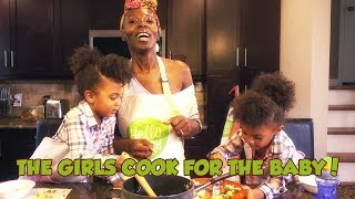 The girls cook for the baby!