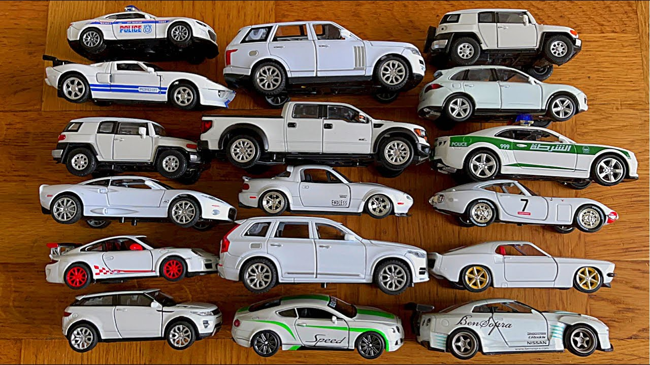 Various Diecast Model Cars From The Floor - White Cars