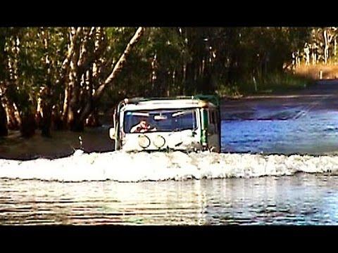Landcruiser HJ47 crossing Magela Creek in Kakadu National Park
