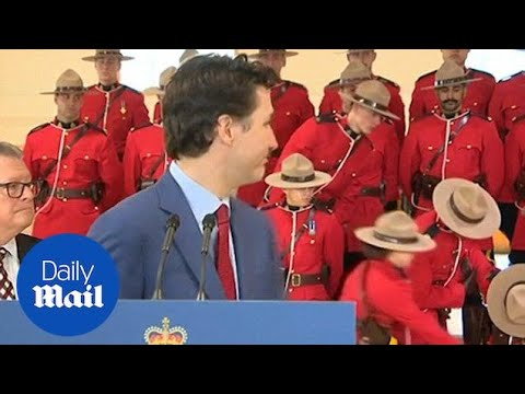 Two members of the Canadian Mounted Police faint behind Trudeau - Daily Mail