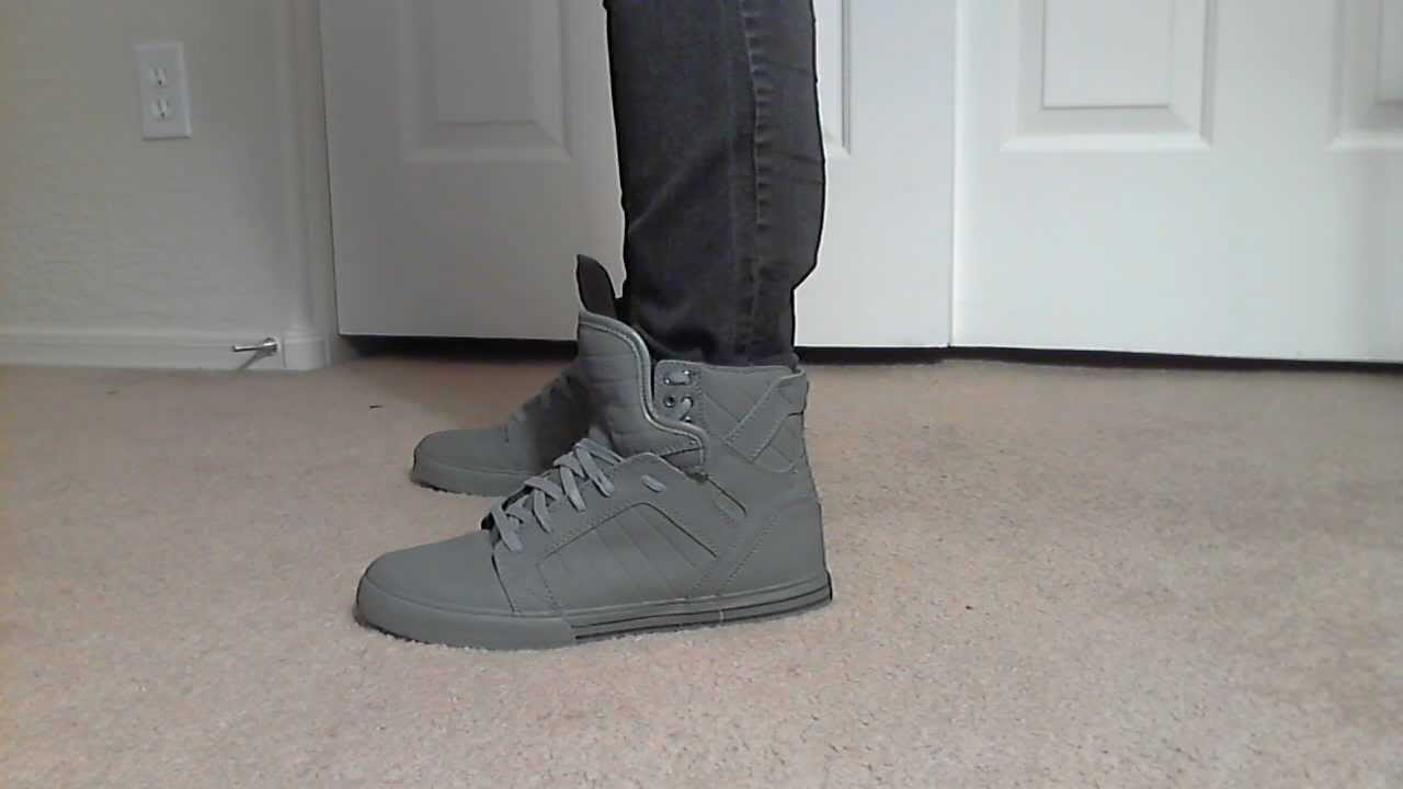White Supra Shoes On Feet