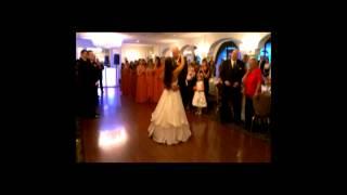 Groom sings first dance song to bride