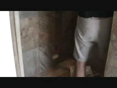 """How to seal a natural stone tile shower: sealing the walls with a """"roller"""""""