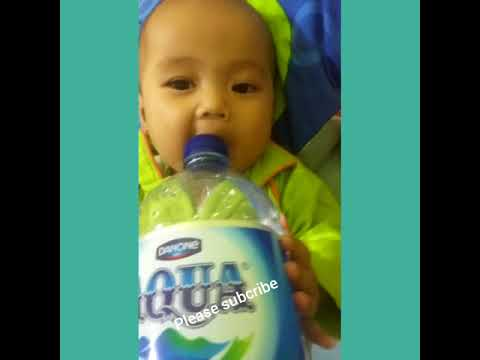 Funny baby ( fight with bottle )