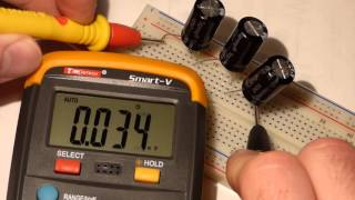 Measuring series and parallel capacitors with electronics multimeter that can tutorial lesson.