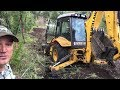 Using Backhoe To Clear Road To Spring