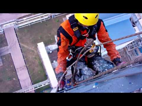 Painting chimney 150 m in Palembang, Indonesia..