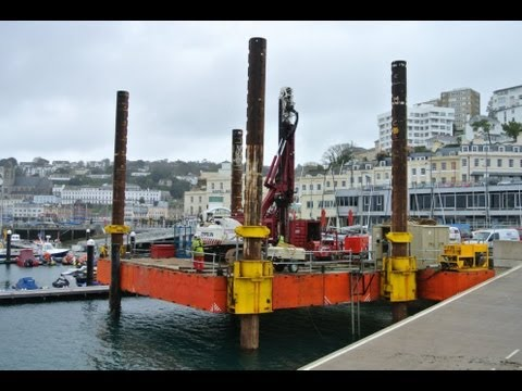 barge with pile driver in Torquay harbour