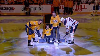 Mike Fisher and his son drop the ceremonial puck