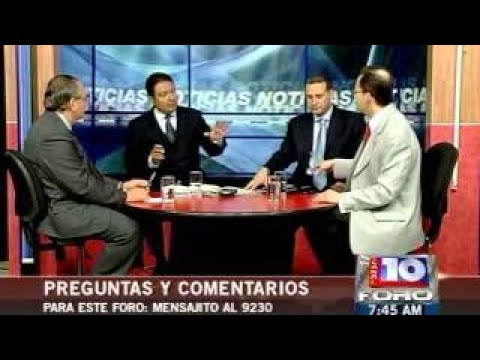 Minister of Natural Resources of Honduras debating with Dr. Sabillon