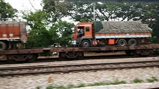 Indian Railways: transporting trucks on train