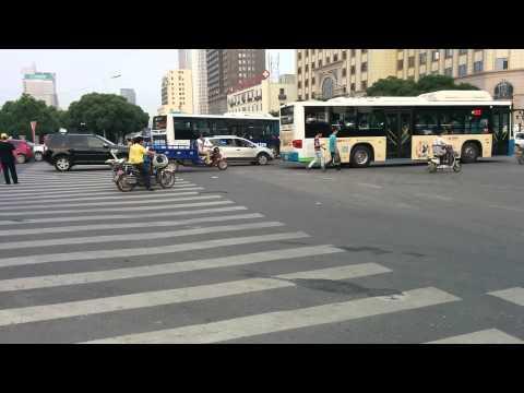 Little boy crossing the street in nanchong