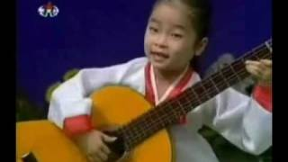 Little Girl Rocks at Guitar .