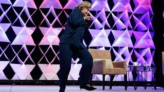 woman throws a shoe at hillary clinton in la at the institute of scrap recycling industries 4 10 14