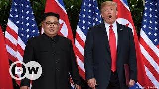 Trump ve Kim'den tarihi el sıkışma - DW Türkçe