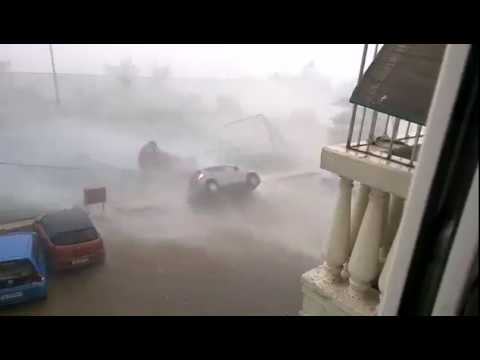 MUST WATCH : CYCLONE DINEO HITS MOZAMBIQUE , WATCH A CAR FLIPS OVER BY STRONG WIND