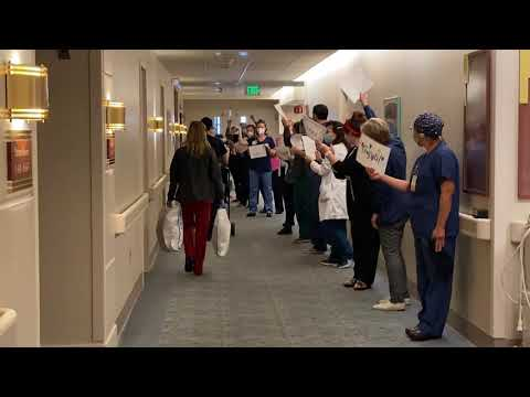A Recovered COVID-19 Patient Is Celebrated As She Leaves Huntington Hospital.