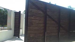 Automated Driveway Gate With Horizontal Wood
