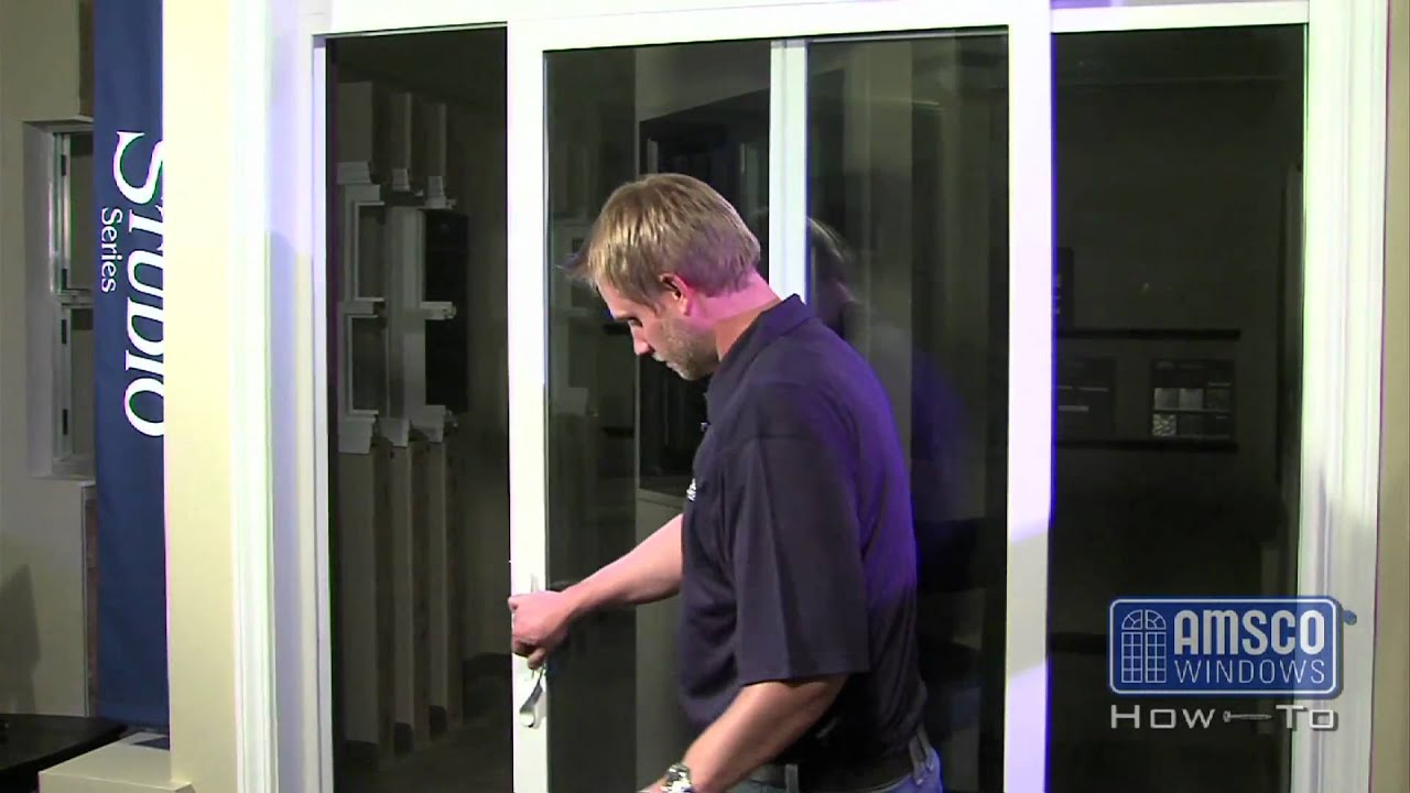 Adjusting the rollers on a sliding patio door youtube for Garage screen door rollers