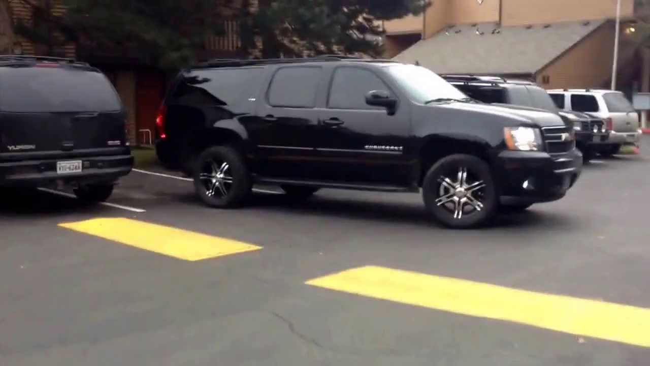 2007 LTZ suburban lifted on 20s with off-road tires making it on 33s