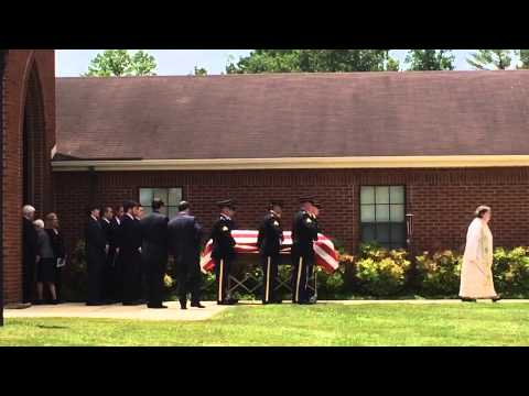 The casket of Sen. Howard H. Baker Jr. receives a military escort