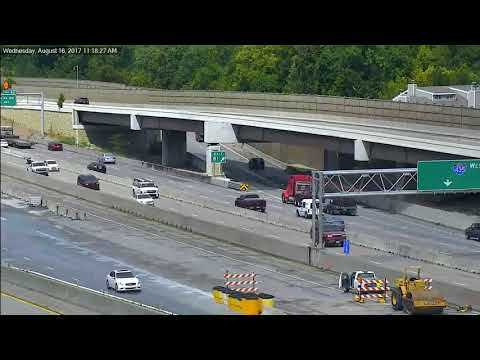 Truck Driver Trapped After Dramatic Crash into Highway Barrier