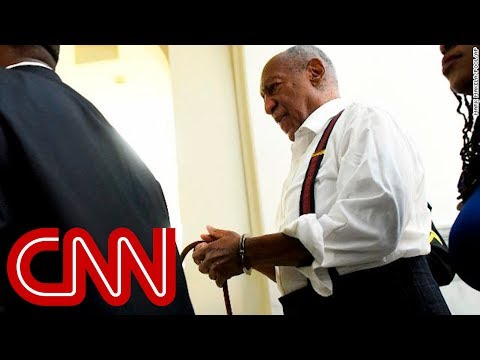 See Bill Cosby leave court in handcuffs