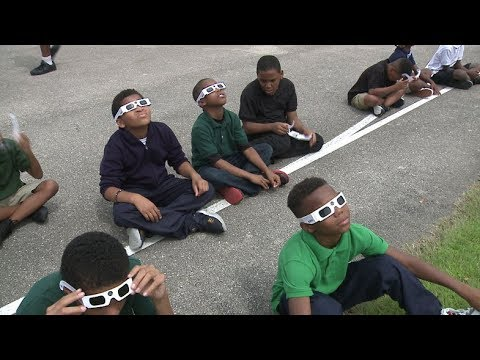 Starms Discovery School fourth-and fifth-graders watch eclipse together