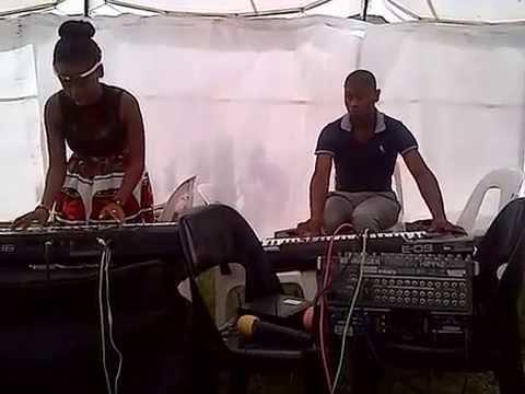 Zukiswa and Letsatsi playing keyboard (tent style)