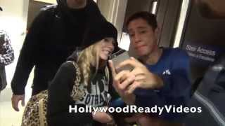 avril lavigne shows love to fans arriving at lax airport in la for a departing flight to brazil