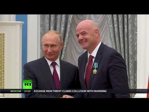 RT America: Putin presents 'Order of Friendship' medal to Infantino