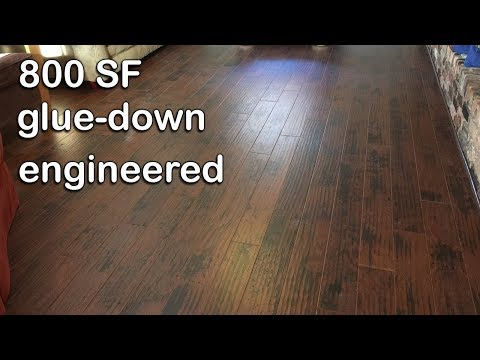 How to glue down engineered floor to a slab.  DIY NC Floor Guys.