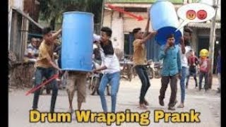 DRUM WRAPPING PRANK ON PUBLIC || PRANK IN INDIA || OYE FUNTOOS