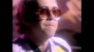 Watch Elton John Breaking Down Barriers video