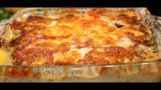 Запеченный минтай с помидорами и сыром