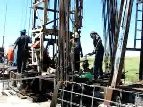 Workover Rig Runnings Rods Back In Oil Well Bryan Texas