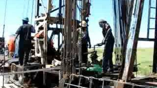 Workover Rig Runnings Rods Back In Oil Well Bryan Texas 2008