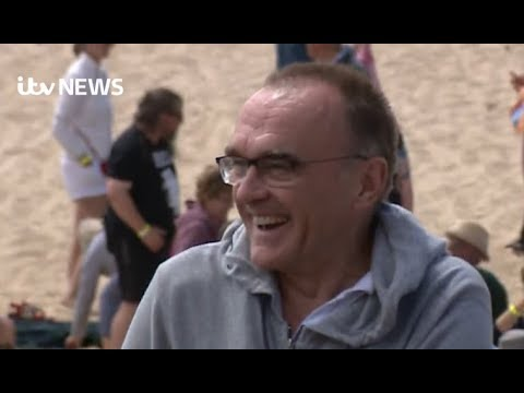 Danny Boyle on a Norfolk beach with 5,000 extras filming his new untitled movie  ITV
