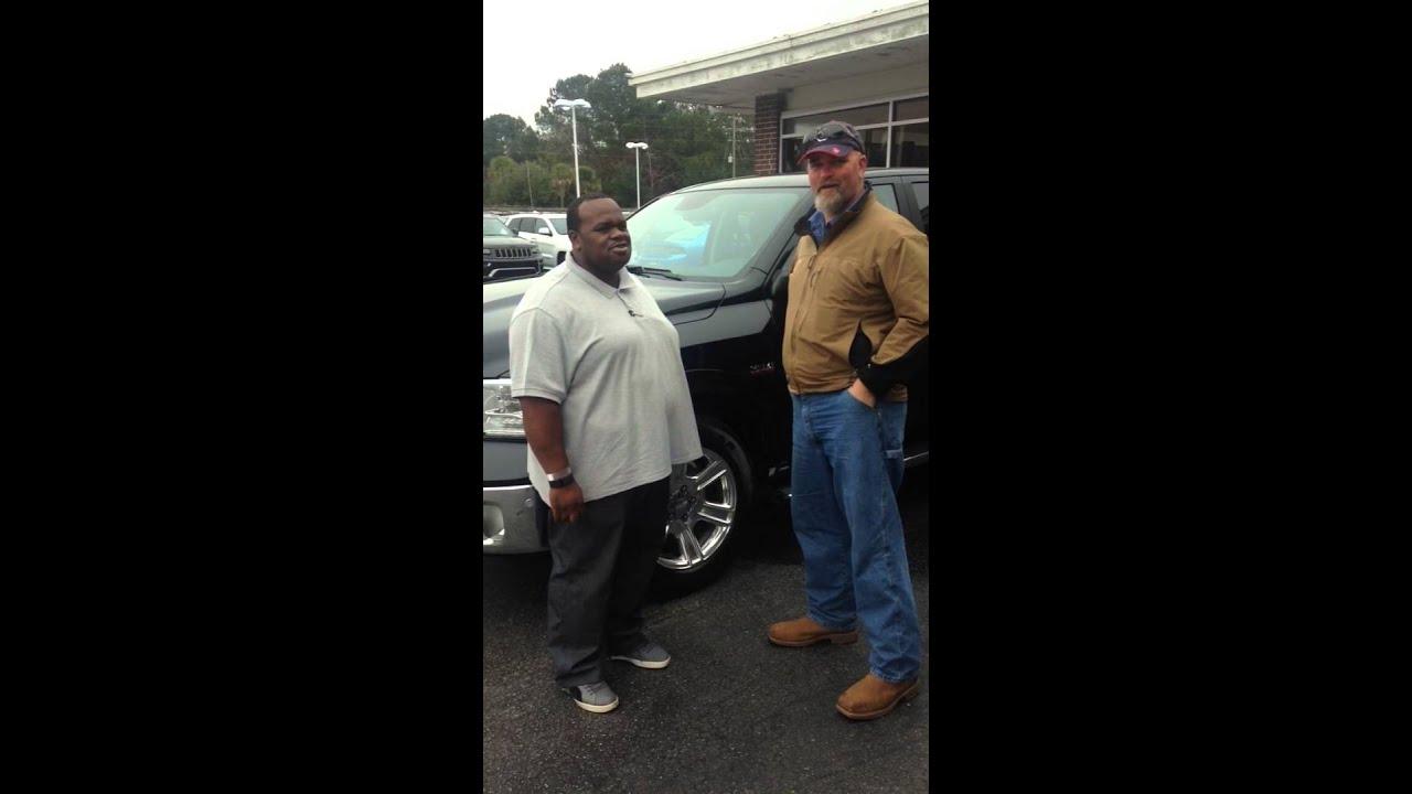 Butler Chrysler Sales Associate Charles Manigo Presents Wayne With