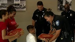 Boy meets officers who delivered him pizza
