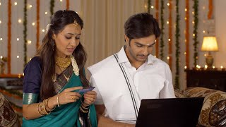 South-Indian couple ordering gifts for their close friends on the occasion of Diwali - shopping concept