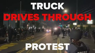Raw video: Truck drives through group of protesters in Portland