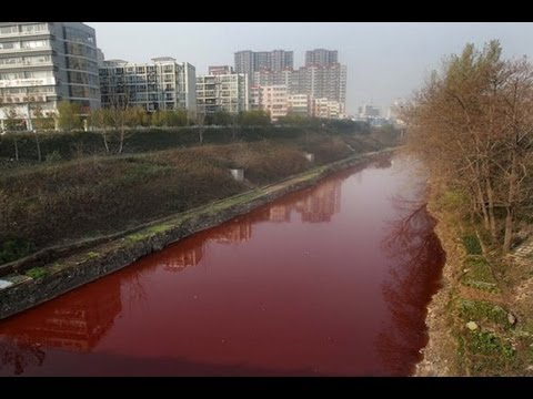 Chinese River Runs Bright Red After Chemical Dumping