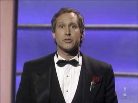 Chevy Chase hosting the 59th Academy Awards®