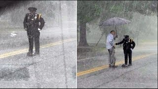 Cop Stands in the Rain During a Storm Until a Couple Drives by and Realizes Why