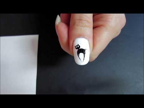 На ногтях рисунки кошек