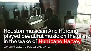 Houston musician plays piano in flooded home
